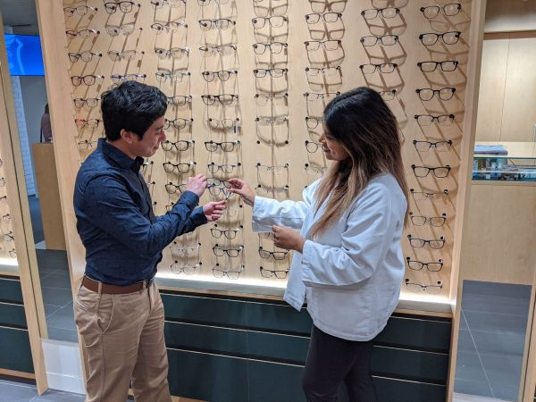 Optometrist helping a patient pick out glasses at the Melbourne Eyecare Clinic