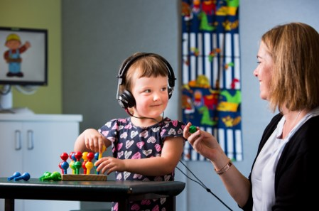 Photograph of a child undertaing a hearing assessment