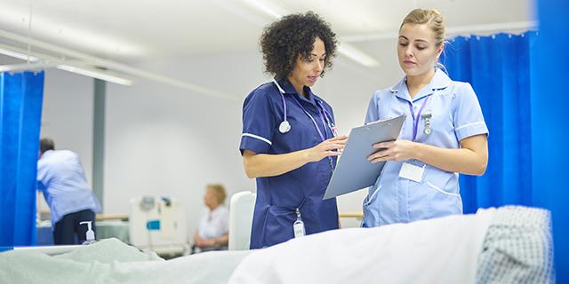 Image of nurses reviewing patient notes